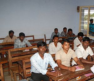 English: Students attending a Class on macro E...