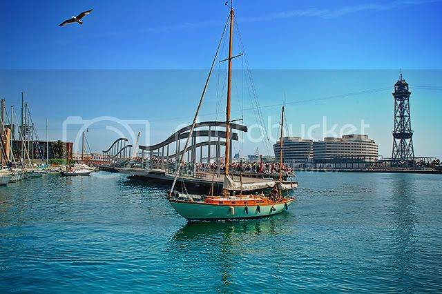Rambla de Mar Lightweight Bridge and Sailing Boat in Barcelona, Spain [enlarge]