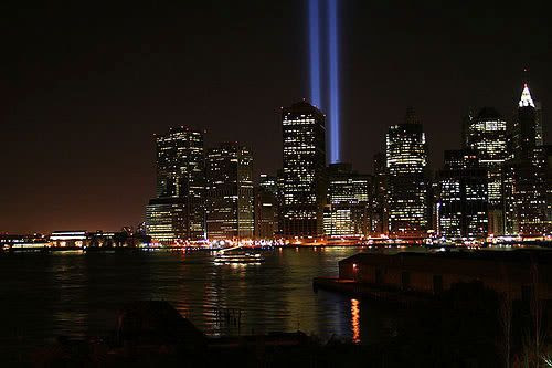 Twin beams representing the World Trade Centers shine high above New York City, on the one-year anniversary of 9/11.