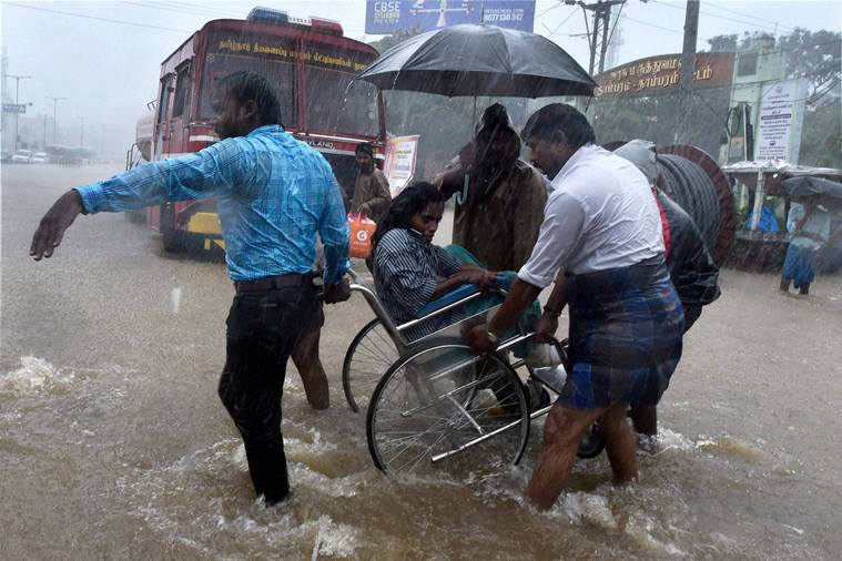 Patients being shifted from a flooded hospital after heavy rains in Chennai on Tuesday. PTI Photo