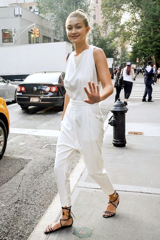 Le Fashion Blog White Jumpsuit Model Off Duty Street Style Gigi Hadid Top Knot Flat Black  Lace Up Sandals Via Laura Thompson photo Le-Fashion-Blog-White-Jumpsuit-Model-Off-Duty-Street-Style-Gigi-Hadid-Top-Knot-Flat-Black--Lace-Up-Sandals-Via-Laura-Thompson.jpg
