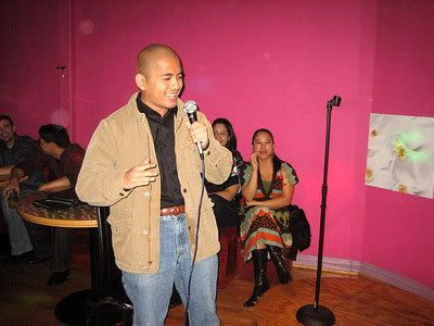 Singing Sisqo's 'The Thong Song' in the karaoke room at the Orchid Lounge.