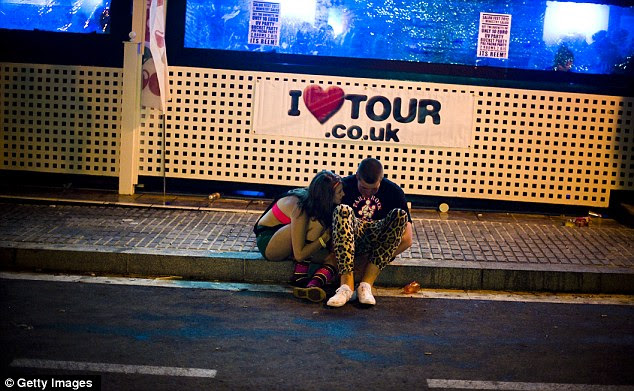 In the gutter: The week-long tour has barely begun, but Saloufest seems to have taken its toll as these two huddle on the pavement outside a nightclub