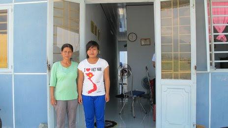 Nguyen Thi Bon and her daughter Vu Thi Hong Thuy at their block house in Da Nang