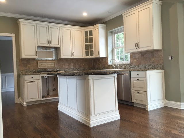 Oak Cabinets refinished to traditional white with Glaze