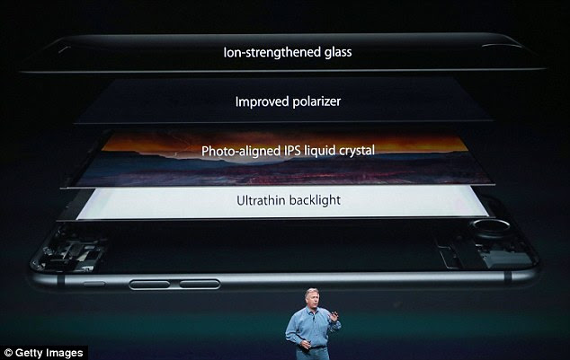 The layers of the new iPhones are pictured, being demonstrated by Phil Schiller, senior vice president of Apple's worldwide marketing