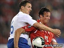 Phil Jagielka in action against Switzerland