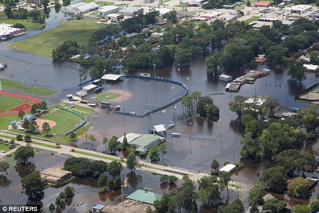 A flooded baseball field at the Gonzales Civic Center pictured above. The White House insists Obama is not indifferent to the suffering of thousands who were washed out of their homes in the Baton Rouge and Lafayette areas