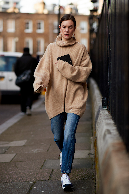 Le Fashion Blog London Fashion Week Street Style Casual Cool Oversized Camel Turtleneck Straight Leg Dark Wash Jeans Sneakers Via Who What Wear