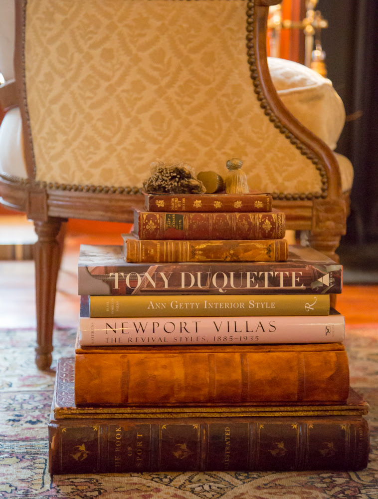 """Stack large, substantial books to create a side table. Keep in mind…they aren't called """"coffee table books"""" for nothing!"""