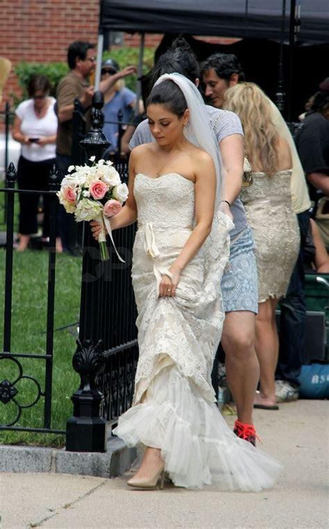 Mila Kunis hiked up her wedding gown.   Mila Kunis Wedding