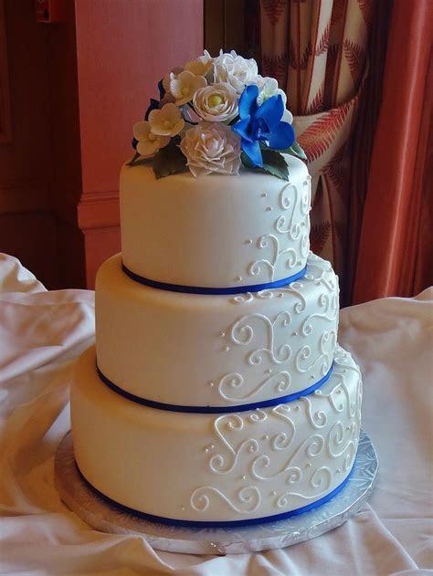 scroll piping  royal blue ribbon  gumpaste flowers