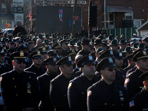 Police officers turn their backs as New York City Mayor