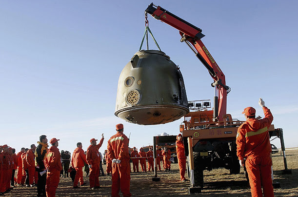 Chinese engineers retrieve the re-entry capsule of Shenzhou VI, China's second manned spacecraft, at its landing site in Siziwang Banner county, in Inner Mongolia.