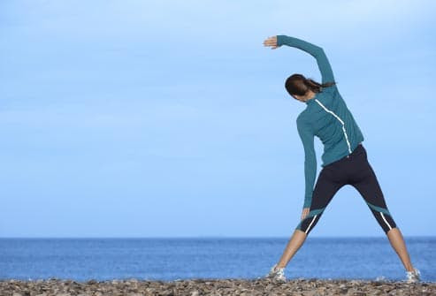 Woman stretching at beach