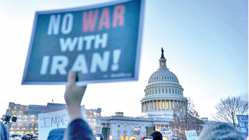 People demonstrate against United States entering a war with Iran on the East Front of the US Capitol on Thursday in Washington.