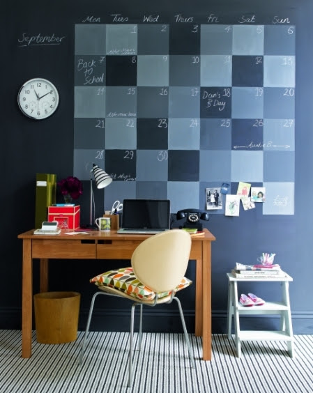 Stylish-interior-design-home-office-with-blue-wall-wood-office-table-modern-chair-laptop-and-office-furniture