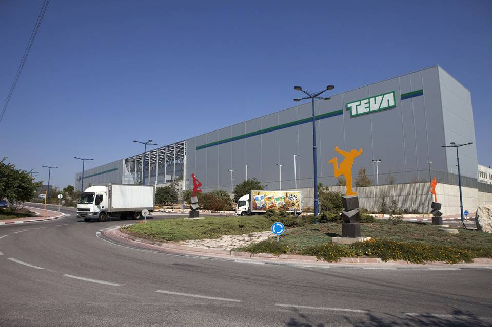 Trucks cross in front of the Teva Pharmaceutical Logistic Center in the town of Shoam, Israel.
