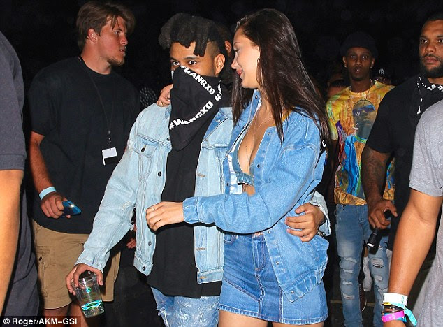 Simple style: Bella layered a denim bra under a jean jacket, which she left open for exposure. To draw attention to her legs, the 19-year-old added a matching mini skirt