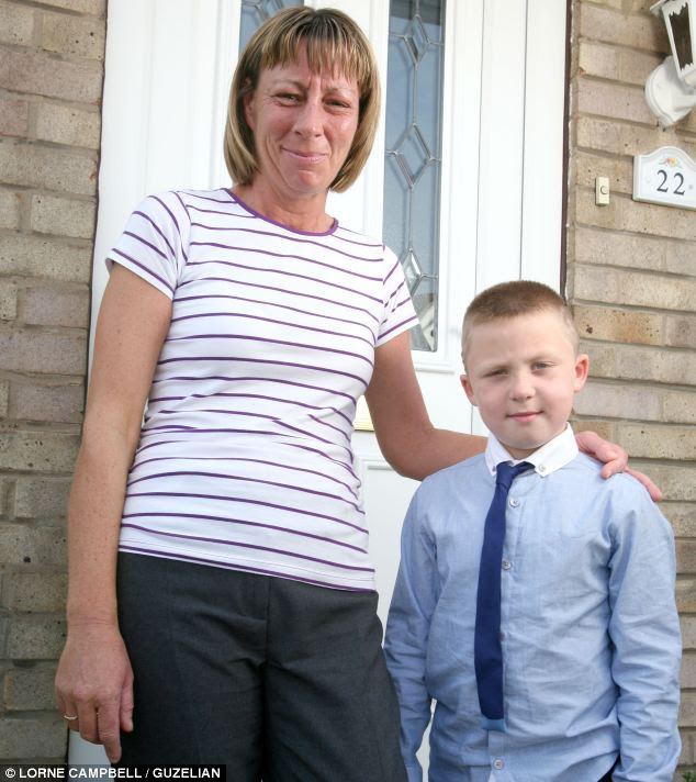 Ms Carroll says that she has taught Kieran (right) what to do in an emergency so he knew that when he could not wake her he should go and find their neighbour, Sandra Best (left)