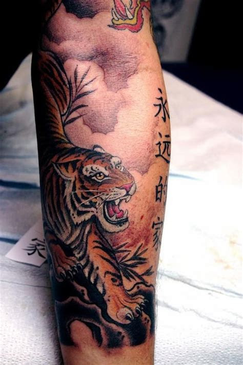 elegant coloured tiger  hieroglyphs tattoo  asian