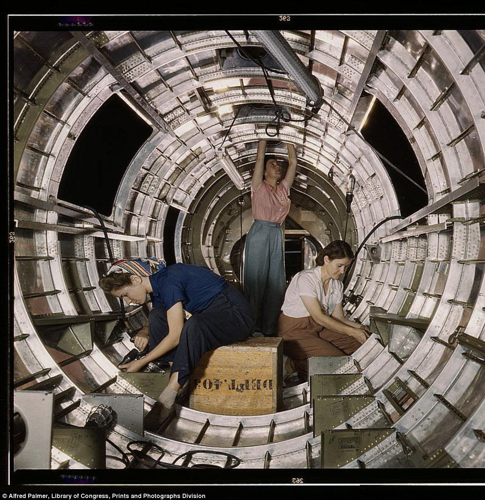 Home front effort: Women workers install fixtures and assemblies to a tail fuselage section of a B-17 bomber at the Douglas Aircraft Company plant in Long Beach, California in October 1942