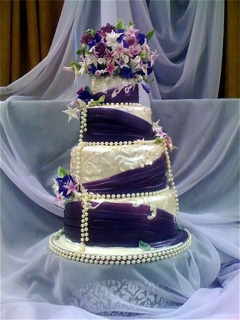 Purple and Pearl Ivory Wedding cake : Purple swags over