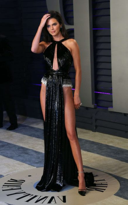 kendall jenner in a super open dress at the vanity fair