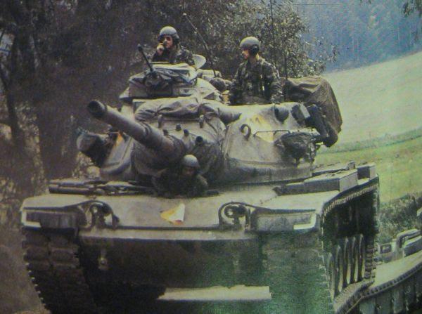 From Air Man, tanks cross a bridge during the war game.