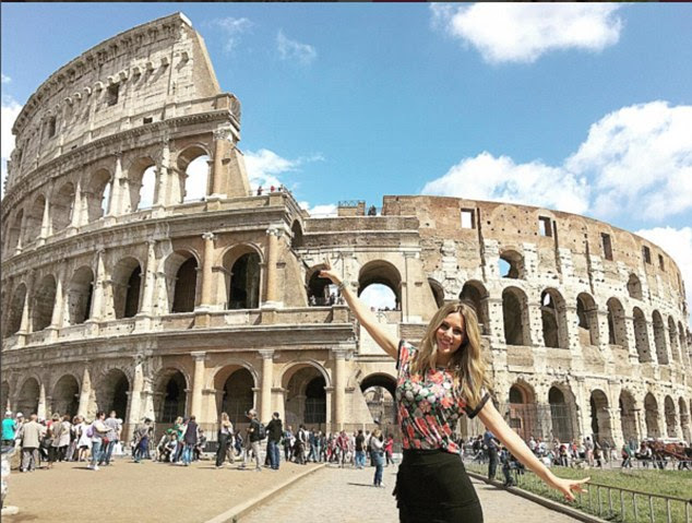 Rome:Just three weeks ago she tried to beat her fellow WAGS on a trip to Italy posting: 'How beautiful is Rome! Amazing Colosseum and the Roman Forum, the most impressive things I've ever seen!'