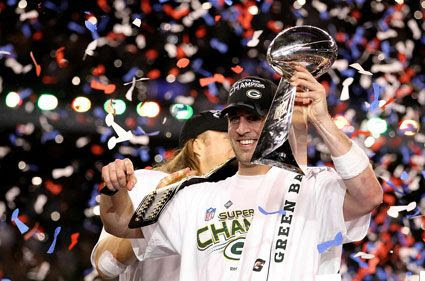 Packers quarterback Aaron Rodgers celebrates with the Lombardi Trophy after his team won 31-25 against the Pittsburgh Steelers in Super Bowl XLV, on February 6, 2011.