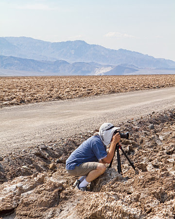 Ed Bannister photographing at Devil's Golf Course, Death Valley during the heat wave on 30 June 2013