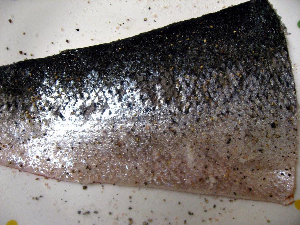 Salmon, seasoned with salt, pepper, and sugar