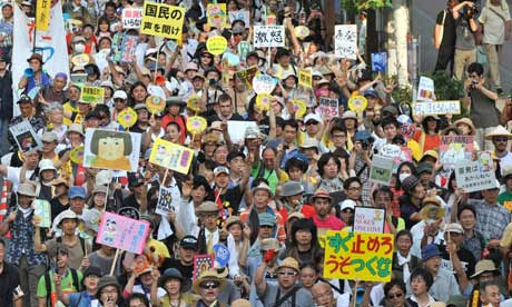 Anti-nuclear activists protest against nuclear power plant in front of Japan parliament in Tokyo