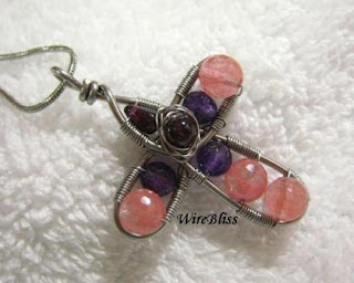 wire cross with Cherry Quartz, amethyst and garnets