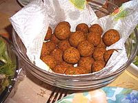 Spherical fritters in a bowl