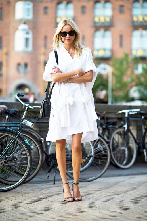 Le Fashion Blog Street Style Editor Hege Aurelie Badendyck White Tie Front Shirtdress With Multiple Ties Small Crossbody Bag Heeled Sandals With Ankle Straps Via T Magazine