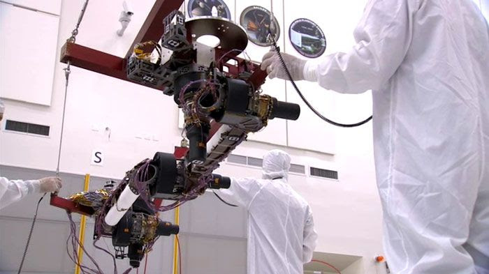 Engineers prepare a robotic arm for installation onto the CURIOSITY Mars Rover at NASA's Jet Propulsion Laboratory in Pasadena, California.