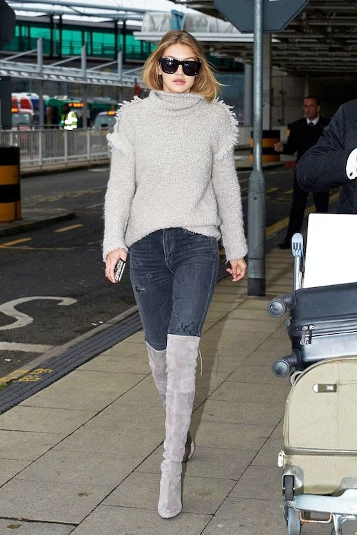 Le Fashion Blog Gigi Hadid Airport Style Grey Fringe Cowl Neck Sweater Distressed Denim Grey Suede Over The Knee Boots Via Vogue