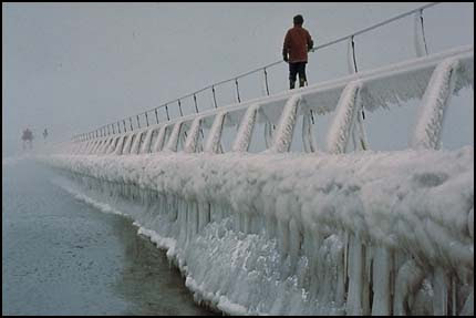 Figure on icy pier
