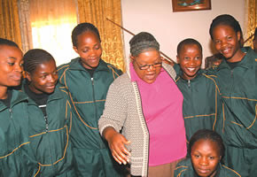 Republic of Zimbabwe Vice-President Joice Mujuru surrounded by the Mighty Warriors Women's Soccer Club at her home. The team came to pay their condolences to the Vice-Presidnet whose husband was killed in a fire recently. by Pan-African News Wire File Photos