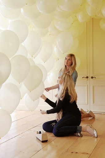 White balloons, and using balloons as a backdrop or background for a party or reception.