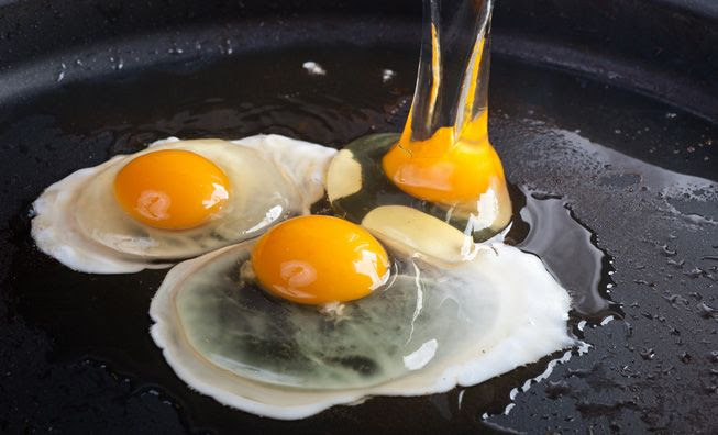 Frying3EggsInAPan.jpg.838x0_q80