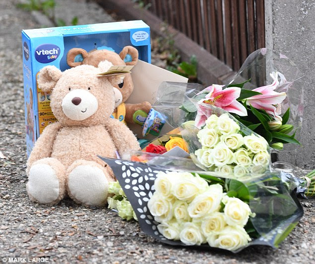 Flowers and children's toys, including teddy bears, were left at the scene by passers-by