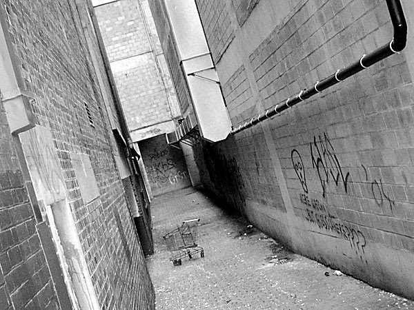 abandoned trolley in a dirty alley
