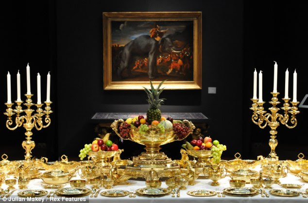 Fine dining: The 1.400 banqueting service is laid out in front of 'Hannibal Crossing The Alps on an Elephant' by Nicolas Poussin at Christie's