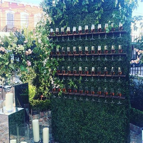 champagne wall perfect way to welcome guests into wedding