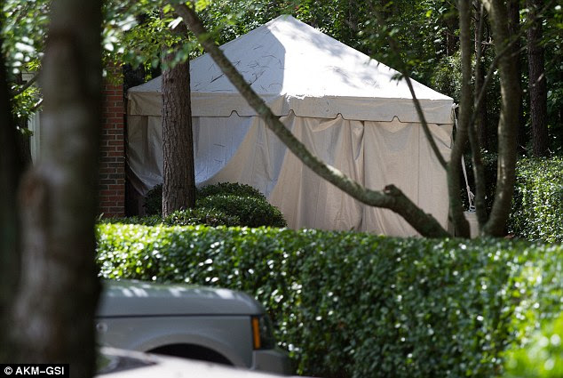 Nothing to see: In recent weeks, a tent (above) appeared at the back door of the Georgia hospice center
