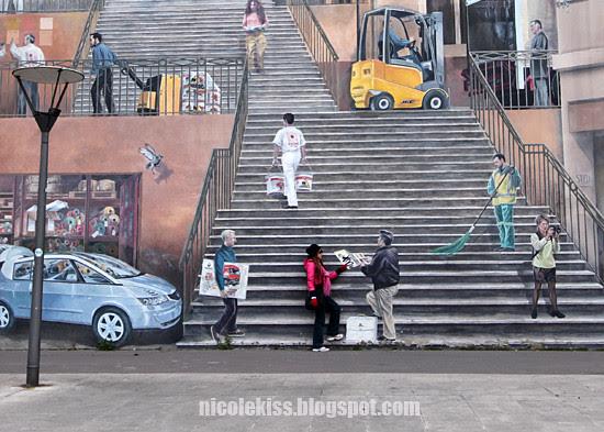 climbing the steps on Lyon mural