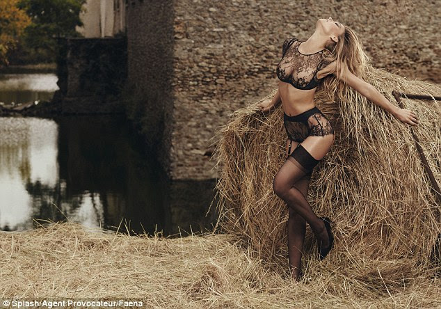 Racy: The stills see Refaeli rolling around in hay as she models delicate lace sets and suspenders